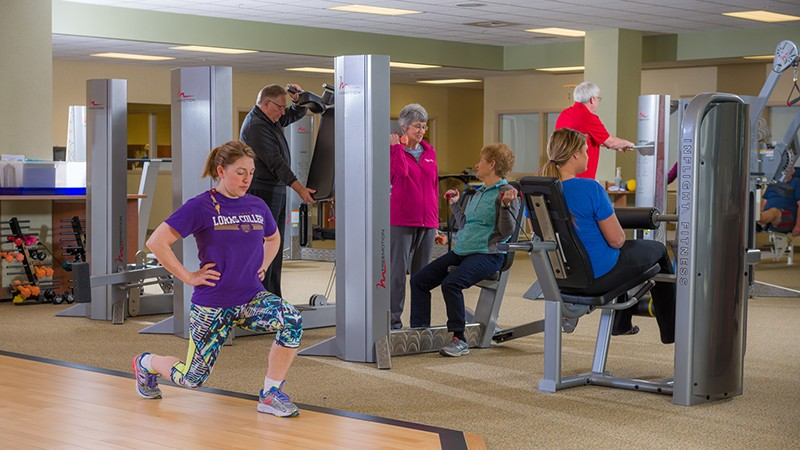 Wellness Fitness Center at Upland Hills Health in Dodgeville, Wisconsin featuring various people using weight machines